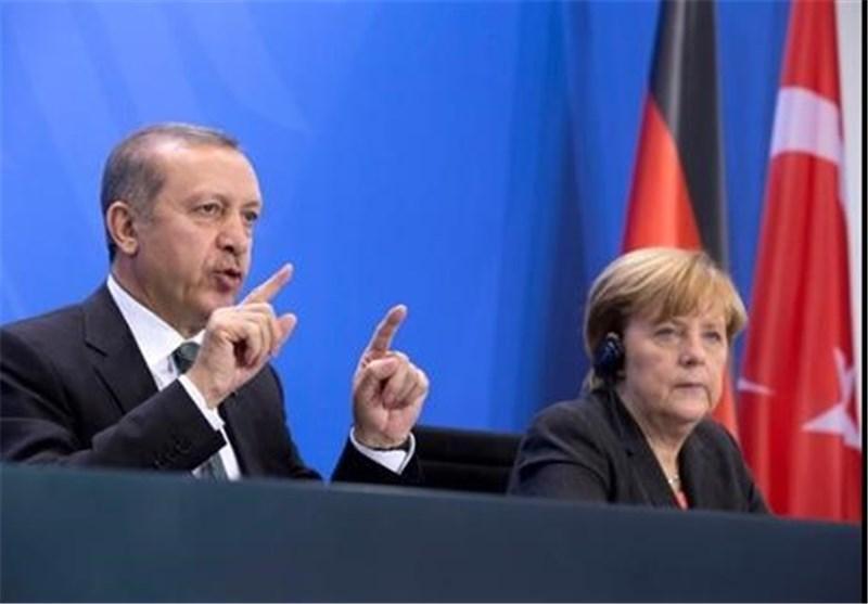 مرکل: برای حل بحران سوریه باید با ایران تعامل گردد